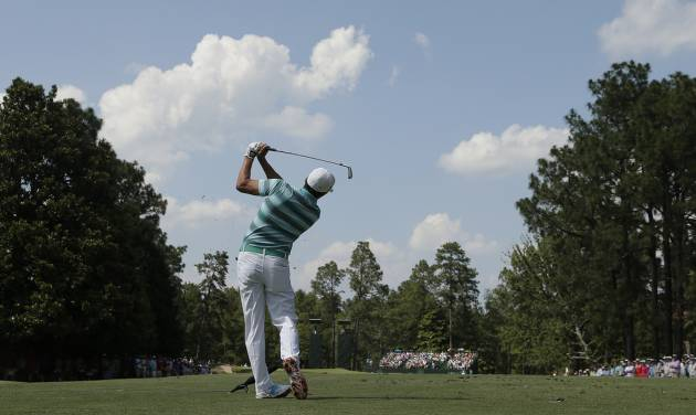 Rickie Fowler watches his tee shot on the ninth hole during the third round of the U.S. Open golf tournament in Pinehurst, N.C., Saturday, June 14, 2014. (AP Photo/Charlie Riedel)