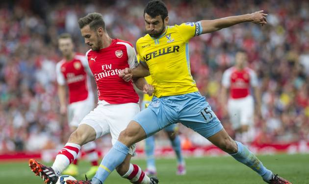 Arsenal's Aaron Ramsey, left, fights for the ball with Crystal Palace's Mile Jedinak during their English Premier League soccer match at Emirates Stadium, in London, Saturday, Aug. 16, 2014. (AP Photo/Bogdan Maran)