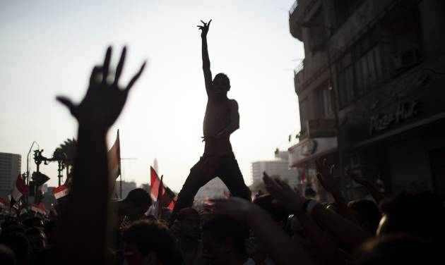 """FILE - In this Wednesday, July 3, 2013 file photo, Egyptian protesters chant slogans against Egyptian Islamist President Mohammed Morsi, who was ousted later that day, in Tahrir Square in Cairo. Almost a quarter-century ago, a young American political scientist achieved global academic celebrity by proclaiming that the collapse of communism had ended the discussion on how to run societies, leaving """"Western liberal democracy as the final form of human government."""" In Egypt and around the Middle East, after a summer of violence and upheaval, the discussion, however, is still going strong.  And almost three years into the Arab Spring revolts, profound uncertainties remain. (AP Photo/ Manu Brabo, File)"""