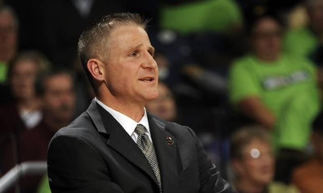 Boston College coach Erik Johnson watches his team in the first half of an NCAA college basketball game with Notre Dame, Thursday, Jan. 9, 2014 in South Bend, Ind. (AP Photo/Joe Raymond)