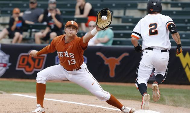 Oklahoma State's Tim Arakawa (2) is safe at first base as Texas first baseman Kacy Clemens (13) receives the ball in the second inning of a semifinal in the Big 12 NCAA college baseball tournament in Oklahoma City, Saturday, May 24, 2014. AP Photo/Sue Ogrocki)