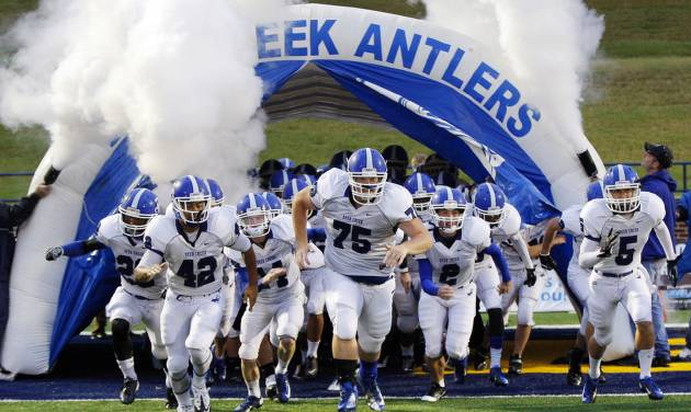 The Deer Creek Antlers take the field before a high school football game between Edmond Memorial and Deer Creek at Wantland Stadium in Edmond, Okla., Thursday, Sept. 13, 2012. Photo by Nate Billings, The Oklahoman