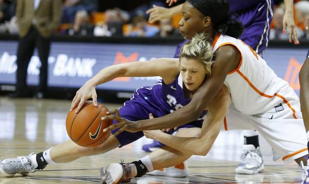 Oklahoma State's Toni Young (15) reaches over TCU's Kamy Cole (11) for the ball during a women's college basketball game between Oklahoma State University and TCU at Gallagher-Iba Arena in Stillwater, Okla., Tuesday, Feb. 5, 2013. Oklahoma State won 76-59.  Photo by Bryan Terry, The Oklahoman