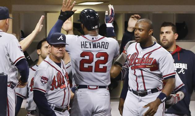 Atlanta Braves' Jason Heyward celebrates with teammates after scoring the tying run in the eighth inning on a single by Chris Johnson against the San Diego Padres of a baseball game Saturday, Aug. 2, 2014, in San Diego. (AP Photo/Don Boomer)