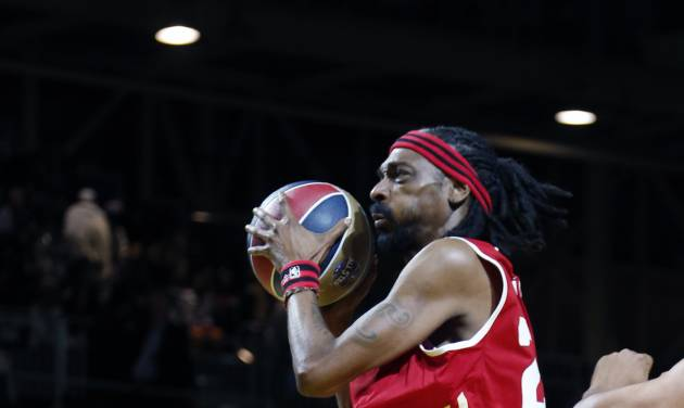 West's Snoop Dogg, aka Snoop Lion, drives to the basket in the second half as he participate in an NBA All-Star Celebrity basketball game against East in New Orleans, Friday, Feb. 14, 2014. East won 60-56. (AP Photo/Bill Haber)