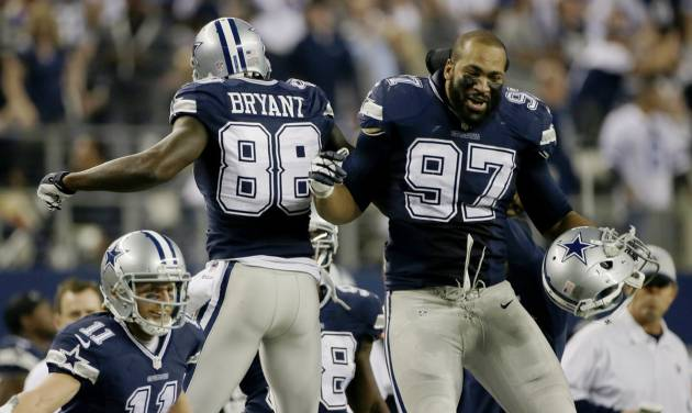 Dallas Cowboys wide receiver Dez Bryant (88) celebrates his touchdown against the Oakland Raiders with Jason Hatcher (97) during the second half of an NFL football game, Thursday, Nov. 28, 2013, in Arlington, Texas.  (AP Photo/Tim Sharp)