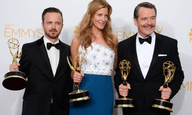 "Aaron Paul, left, poses with the award for outstanding supporting actor in a drama series, with Anna Gunn, center, with the award for outstanding supporting actress in a drama series, and Bryan Cranston with the awards for outstanding lead actor in a drama series and outstanding drama series for ""Breaking Bad"" in the press room at the 66th Annual Primetime Emmy Awards at the Nokia Theatre L.A. Live on Monday, Aug. 25, 2014, in Los Angeles. (Photo by Jordan Strauss/Invision/AP)"