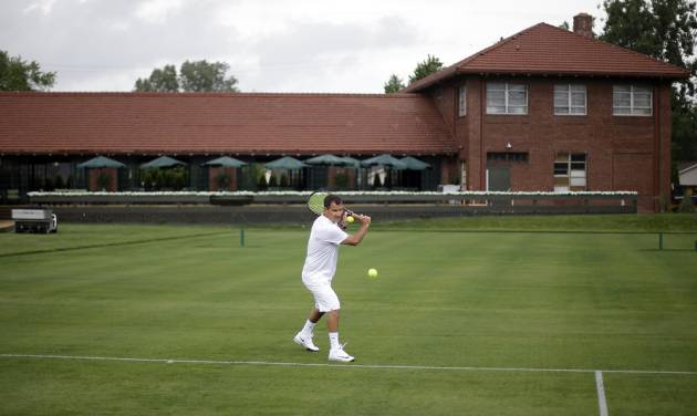 Armand Molino plays tennis at the Wessen Lawn Tennis Club in Pontiac, Mich., Tuesday, June 24, 2014. The club's owner is hoping to impress the ATP Tour enough to bring a tournament to the site in a couple years. Bill Massie says he has spent $1.5 million to build 24 outdoor grass courts, adding he has plans to add seven hard and three clay courts in the future. (AP Photo/Paul Sancya)