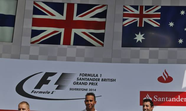 Britain's Lewis Hamilton of Mercedes centre, who won the race, Finland's Valtteri Bottas of Williams, left, who finished second, and Australia's Daniel Ricciardo, right,  of Red Bull finished third stand n the podium after winning the British Formula One Grand Prix at Silverstone circuit, Silverstone, England, Sunday, July 6, 2014. (AP Photo/Lefteris Pitarakis)