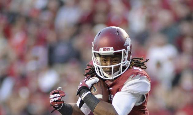 In this photo taken on Nov. 2, 2013, Arkansas wide receiver Keon Hatcher carries in the first half of an NCAA college football game against Auburn in Fayetteville, Ark. (AP Photo/Beth Hall)