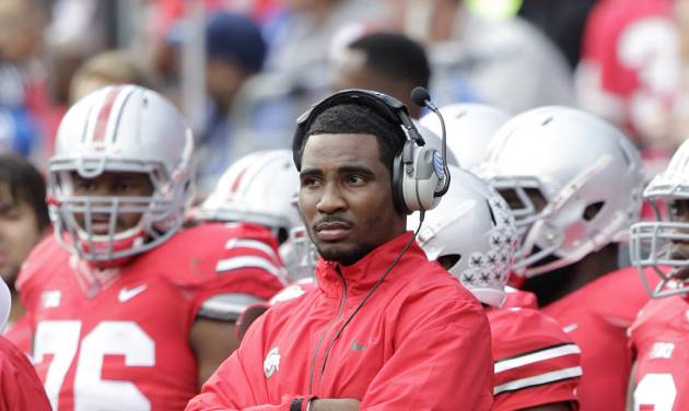 FILE - In this Sept. 21, 2013, file photo, Ohio State quarterback Braxton Miller watches from the sidelines as Ohio plays against Florida A&M during the first quarter of an NCAA college football game in Columbus, Ohio. Miller, among the top contenders for the Heisman Trophy, reportedly reinjured his throwing shoulder during practice. The report about the two-time Big Ten offensive player of the year comes with just more than two weeks before the No. 5 Buckeyes open the season. (AP Photo/Jay LaPrete, File)