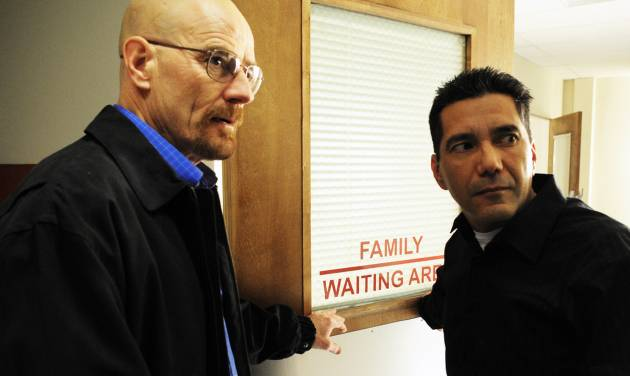 """This 2009 image released by AMC shows actors Bryan Cranston as Walter White, left, and Steven Michael Quezada as Steven Gomez in a scene from the third season of """"Breaking Bad.""""  Quezada, who plays federal drug agent Steven Gomez on the Albuquerque-based show, is running unopposed Tuesday, Feb. 5, 2013, for a seat on Albuquerque's school board. (AP Photo/AMC)"""