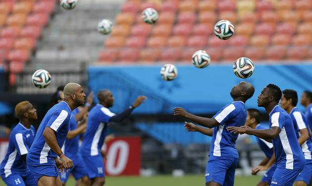 Honduras' players practice headers during a training session at the Arena da Amazonia in Manaus, Brazil, Tuesday, June 24, 2014, one day before the group E match between Honduras and Switzerland of the 2014 soccer World Cup. (AP Photo/Frank Augstein)