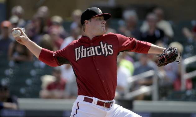 Arizona Diamondbacks starting pitcher Archie Bradley throws to the Seattle Mariners during the first inning of a spring exhibition baseball game in Scottsdale, Ariz., Thursday, March 13, 2014. (AP Photo/Chris Carlson)
