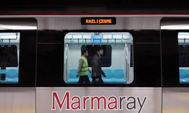 Two Japanese technicians  walk inside a train for the inauguration of the tunnel called Marmaray in Istanbul, Turkey, Tuesday, Oct. 29, 2013. Turkey is for the first time connecting its European and Asian sides with a railway tunnel set to open Tuesday, completing a plan initially proposed by an Ottoman sultan about 150 years ago. The  Marmaray, is among a number of large infrastructure projects under the government of Prime Minister Recep Tayyip Erdogan that have helped boost the economy but also have provoked a backlash of public protest.(AP Photo)
