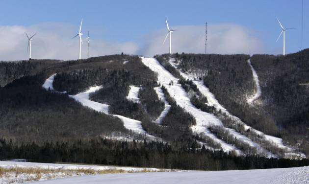 FILE - In this file photo made Jan. 17, 2007, wind turbines stand atop Mars Hills Mountain in Mars Hill, Maine. FirstWind and other wind power companies in Maine are working with snowmobilers' groups to make their sites destinations for winter sledders via 600 miles of trails that are mostly there already. (AP Photo/Robert F. Bukaty, File)