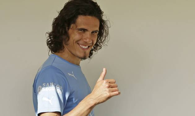 Uruguay's Edinson Cavani gestures to supporters at his team's hotel in Natal, Brazil, Wednesday, June 25, 2014. Uruguay will face Colombia in round 16 at the World Cup. (AP Photo/Petr David Josek)