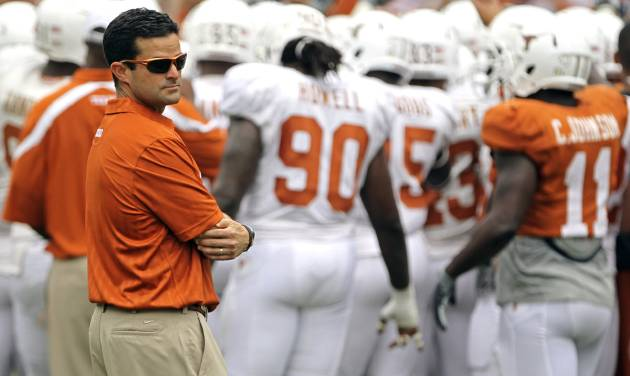 Former Texas defensive coordinator Manny Diaz stands on the sideline before a  2011 scrimmage in Austin, Texas. Diaz was fired after Saturday's 40-21 loss to BYU. AP Photo