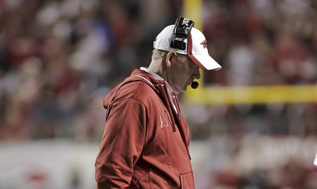 In this Nov. 19, 2011, photo, Arkansas football coach Bobby Petrino walks to the sideline as the Razorbacks took on Mississippi State during an NCAA college football game in Little Rock, Ark. Arkansas fired coach Petrino on Tuesday, April 10, 2012, publicly dressing him down for unfairly hiring his mistress and intentionally misleading his boss about everything from their relationship to her presence at the motorcycle accident that ultimately cost him his job. (AP Photo/El Dorado News-Times, Michael Orrell) MANDATORY CREDIT