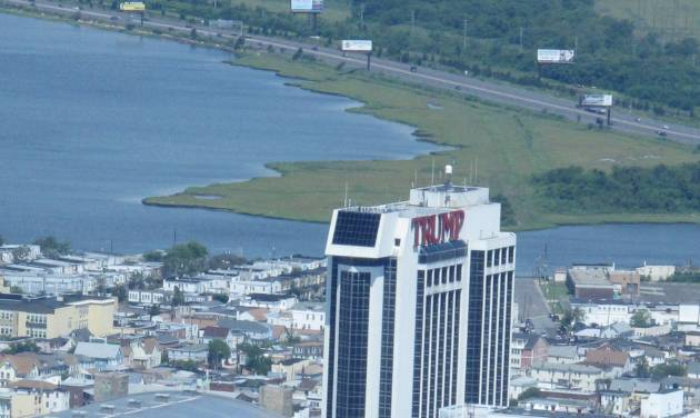 Trump Plaza Hotel and Casino in Atlantic City N.J., shown here on July 11, 2014, will shut down on Sept. 16, its parent company told The Associated Press on Saturday July 12, 2014. It would be the third Atlantic City casino to shut down this year, and more than 1,000 workers would lose their jobs. (AP Photo/Wayne Parry)