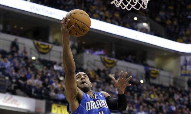 Orlando Magic guard Arron Afflalo gets a bucket on a fast break in front of Indiana Pacers guard George Hill in the first half of an NBA basketball game in Indianapolis, Monday, Feb. 3, 2014. (AP Photo/Michael Conroy)