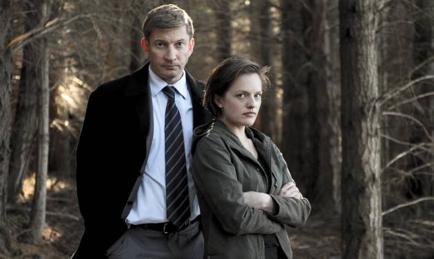 """This undated publicity image released by Sundance Channel shows David Wenham, left, and Elisabeth Moss in the Sundance Channel original miniseries """"Top of the Lake"""". A TV miniseries and movie comeback will mean more Emmy Awards than expected at this year's ceremony. The TV academy's board of governors said it's reversing its 2012 decision to combine lead and supporting acting honors for such projects. In a statement, the board said that because of the """"unanticipated resurgence"""" of TV miniseries and movies, it was reinstating the separate acting categories. The board was swayed by a rich field of potential contenders, including Elisabeth Moss and Holly Hunter in Sundance Channel's """"Top of the Lake"""" and Ben Whishaw and Dominic West in BBC America's """"The Hour."""" (AP Photo/Sundance Channel, Parisa Taghizadeh)"""