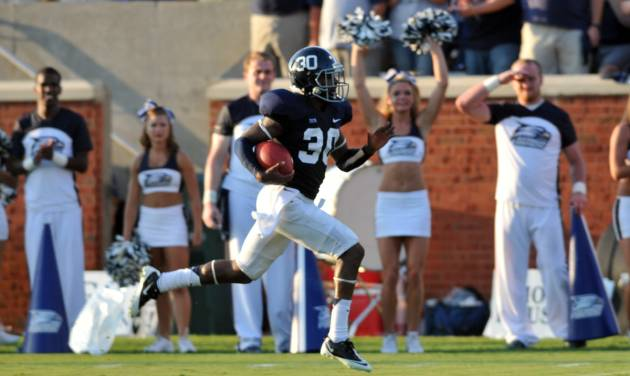 Georgia Southern cornerback Valdon Cooper races to the end zone for a touchdown after an interception against Jacksonville during the first half of an NCAA college football game, Saturday, Sept. 1, 2012, in Statesboro, Ga. (AP Photo/The Morning News, Richard Burkhart) THE EXAMINER.COM OUT; SFEXAMINER.COM OUT; WASHINGTONEXAMINER.COM OUT