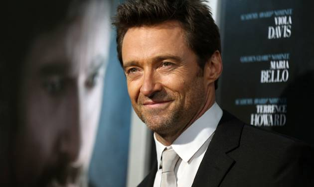 "FILE - In this Sept. 12, 2013 photo, Hugh Jackman arrives at the premiere of ""Prisoners"" at The Academy of Motion Picture Arts and Sciences in Beverly Hills, Calif.  A renovated opera house in a small northern Iowa city that's served as a movie theater for decades will get a dose of star power when  Jackman visits for its reopening. The international star's appearance at the 114-year-old Metropolitan Theater in Iowa Falls on Sept. 21, 2013,  may seem unusual, but new theater owner John Whitesell doesn't think so. He says the Australian actor, who is a family friend, called him a few months ago expressing appreciation for his efforts to restore the rundown theater.(Photo by Jose Flores/Invision/AP)"