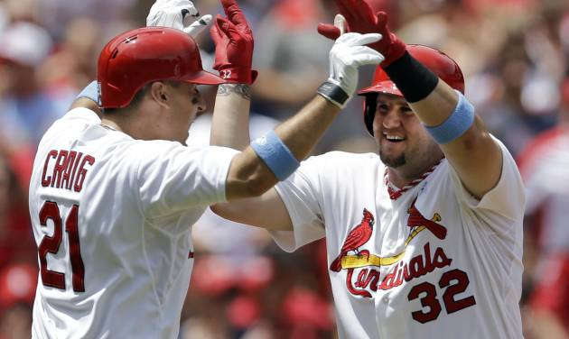St. Louis Cardinals' Matt Adams, right, is congratulated by teammate Allen Craig after hitting a two-run home run during the second inning of a baseball game against the Washington Nationals, Sunday, June 15, 2014, in St. Louis. (AP Photo/Jeff Roberson)