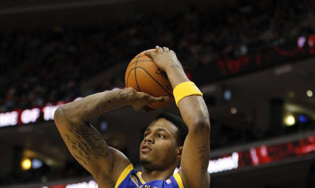 In this photo taken March 2, 2012, Golden State Warriors forward Brandon Rush shoots the ball in the first half of an NBA basketball game against the Philadelphia 76ers in Philadelphia. The Warriors have re-signed Rush on Tuesday, July31, 2012, to an $8 million, two-year contract. (AP Photo/Alex Brandon)