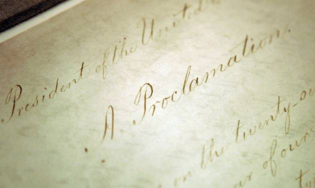 "FILE - This Feb. 18, 2005 file photo shows the original Emancipation Proclamation on display in the Rotunda of the National Archives in Washington. As New Year's Day approached 150 years ago, all eyes were on President Abraham Lincoln in expectation of what he warned 100 days earlier would be coming _ his final proclamation declaring all slaves in states rebelling against the Union to be ""forever free."" A tradition began on Dec. 31, 1862, as many black churches held Watch Night services, awaiting word that Lincoln's Emancipation Proclamation would take effect as the country was in the midst of a bloody Civil War. Later, congregations listened as the president's historic words were read aloud. (AP Photo/Evan Vucci, File)"