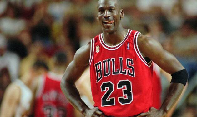 FILE - In this June 9, 1996 file photo Chicago Bulls Michael Jordan stands during a break at the end of an NBA Basketball game against the Seattle SuperSonics in Seattle. A Bismarck, N.D., man who used to own McDonald's restaurants is about $10,000 richer after selling a 20-year-old container of McJordan barbecue sauce Monday, Oct. 15, 2012, to a buyer in Chicago. The sauce was used on McJordan Burgers, named for basketball icon in limited markets for a short time in the 1990s, when Jordan led the Chicago Bulls to six NBA championships. (AP Photo/Beth A. Keiser, File)