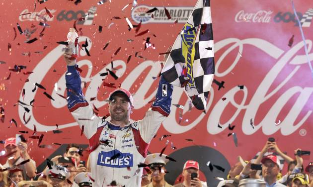 Jimmie Johnson celebrates in Victory Lane after winning the NASCAR Sprint Cup series Coca-Cola 600 auto race at Charlotte Motor Speedway in Concord, N.C., Sunday, May 25, 2014. (AP Photo/Chuck Burton)