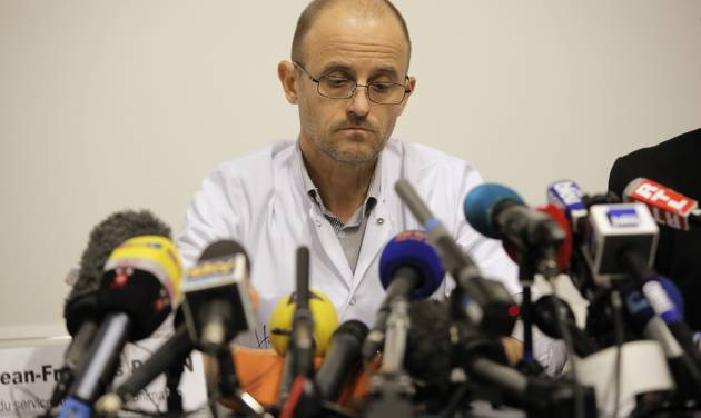 """Professor Jean-Francois Payen answers questions from journalists during a press conference at the Grenoble hospital, in the French Alps, where former seven-time Formula One champion Michael Schumacher is being treated after sustaining a head injury during a ski accident in Meribel, France, Monday, Dec. 30, 2013. Doctors treating Michael Schumacher refused Monday to predict the outcome for the former Formula One driver, saying they were taking his very critical head injury """"hour by hour"""". Chief anesthesiologist Jean-Francois Payen told reporters that the seven-time champion is still in a medically induced coma. (AP Photo/Laurent Cipriani)"""