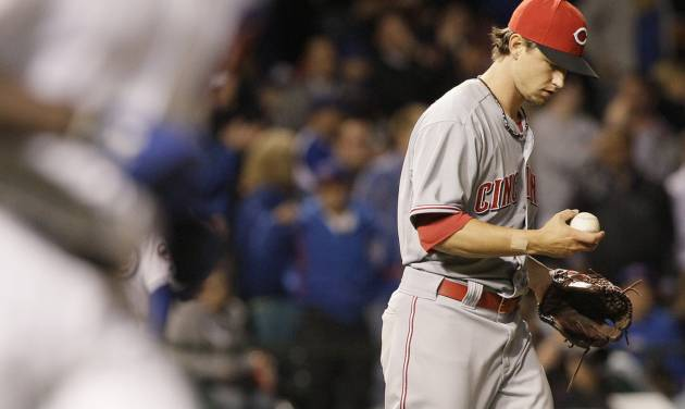Cincinnati Reds starter Mike Leake checks the ball after Chicago Cubs' Alfonso Soriano hit a two-run home run during the sixth inning of a baseball game in Chicago, Wednesday, Sept. 19, 2012. (AP Photo/Nam Y. Huh)