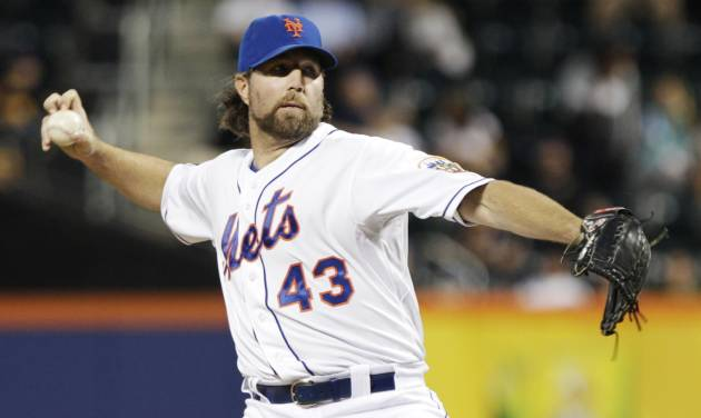 New York Mets' R.A. Dickey (43) delivers a pitch during the first inning of a baseball game against the Washington Nationals Tuesday, Sept. 11, 2012, in New York. (AP Photo/Frank Franklin II)