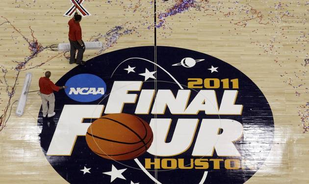 FILE - In this April 4, 2011, file photo, workers sweep confetti off the court following the men's NCAA Final Four college basketball championship game between Butler and Connecticut in Houston. Barely a month ago, the NCAA was shamed into apologizing for trying to rig its own investigation into funny business at the University of Miami. According to a new report, that apology didn't go nearly far enough. (AP Photo/David J. Phillip, File)