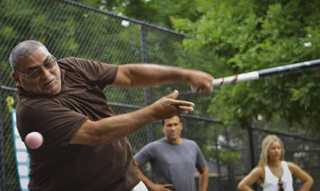Danny Batisa misses the ball during a game of stickball in East Harlem, N.Y., Friday, July 12, 2013. Six players are being inducted into the Stickball Hall of Fame by a committee of so-called old timers who have been following the famous urban sport since its heyday in the 1940s and 50s. (AP Photo/Bethan McKernan)