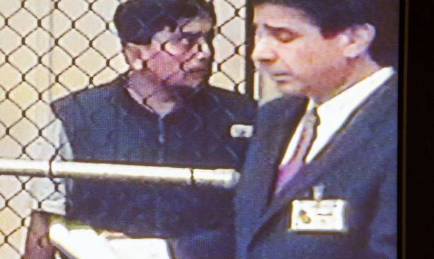 In this video image, Isidro Medrano Garcia, 42,  talks with his Defense attorney Charles Frisco as he appears before Judge Craig Robison Thursday, May 22, 2014  during his arraignment at the Orange County jail in Santa Ana, Calif. Prosecutors on Thursday filed five felony charges against Garcia, including rape and kidnapping to commit a sexual offense. He did not enter a plea, and his arraignment was continued until June. He is being held on $1 million bail.  (AP Photo/The Orange County Register, Ken Steinhardt)   MAGS OUT; LOS ANGELES TIMES OUT