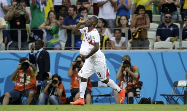 Costa Rica's Joel Campbell celebrates scoring his side's first goal during the group D World Cup soccer match between Uruguay and Costa Rica at the Arena Castelao in Fortaleza, Brazil, Saturday, June 14, 2014.  (AP Photo/Christophe Ena)