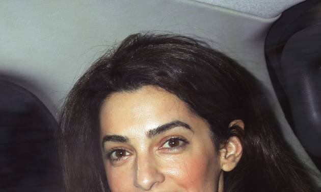FILE - This Feb. 7, 2011 file photo shows human rights attorney Amal Alamuddin, in London. Hollywood's most determined bachelor, George Clooney, recently proposed to the 36-year-old Alamuddin, despite repeated protestations that marriage wasn't for him.  A spokesman for the Oscar-winning actor and producer did not respond to requests for comment Monday, April 28, 2014.  (AP Photo/PA, Yui Mok, File)  UNITED KINGDOM OUT  NO SALES  NO ARCHIVE