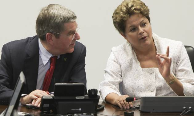 International Olympic Committee (IOC) President Thomas Bach, left, speaks with Brazil's President Dilma Rousseff during a meeting at Planalto Palace in Brasilia, Brazil, Tuesday, Jan. 21, 2014. The city of Rio de Janeiro will host the Olympics in 2016. (AP Photo/Joel Rodrigues)