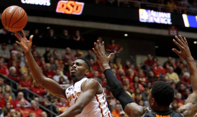 Iowa State forward Melvin Ejim puts up an off blanace shot over Oklahoma State guard/forward Le'Bryan Nash (2) during the second half of an NCAA college basketball game in Ames, Iowa, Saturday, March 8, 2014. (AP Photo/Justin Hayworth)