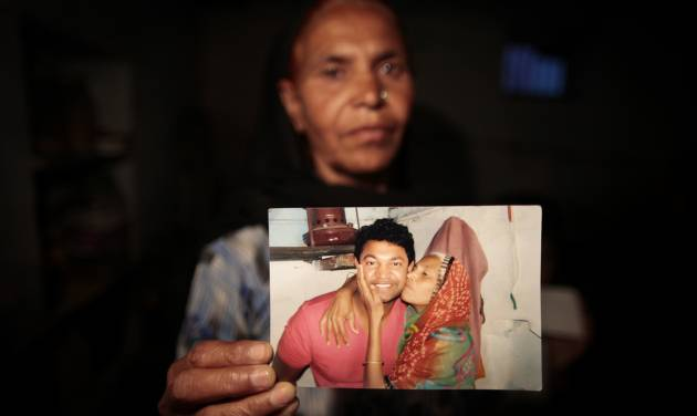 In this May 10, 2012 photo, Fatima Munshi, mother of Saroo, holds up a photo from their reunion in February 2012 at her home in Khandwa, India. Living in Australia, Saroo Brierley, 30, was reunited with his biological mother, Munshi, 25 years after an ill-fated train ride left him an orphan on the streets of Calcutta. (AP Photo/Saurabh Das)