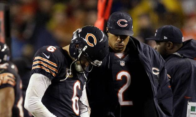 Chicago Bears quarterback Jay Cutler (6) talks with backup quarterback Jason Campbell (2) on the sidelines after Cutler took a late hit from Houston Texans linebacker Tim Dobbins in the first half of an NFL football game in Chicago, Sunday, Nov. 11, 2012. The Texans won 13-6. Campbell replaced Cutler, who did not return in the second half after suffering a concussion. (AP Photo/Nam Y. Huh)