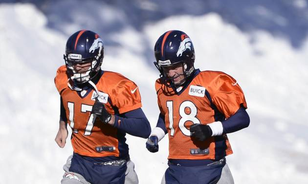Denver Broncos quarterback Peyton Manning (18) and Denver Broncos quarterback Brock Osweiler (17) head to drills  during practice at Dove Valley as they prepare for an NFL football game against the San Diego Chargers in the Divisional Round of the Playoffs on Jan. 6, 2014, in Englewood, Colo.  (AP Photo/The Denver Post, John Leyba) MAGS OUT; TV OUT; INTERNET OUT; NO SALES; NEW YORK POST OUT; NEW YORK DAILY NEWS OUT