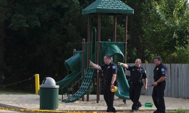 In this Aug. 4, 2014 photo, Kentwood police investigate a stabbing that occurred in a playground in Pinebrook Village, in Kentwood, Mich. Police said a 12-year-old boy has stabbed a 9-year-old boy at the playground in western Michigan, sending the child to a hospital. Police also didn't immediately release detail on the condition of the wounded child. The older boy was taken into custody for questioning by police. (AP Photo/The Grand Rapids Press, Joel Bissell) ALL LOCAL TELEVISION OUT; LOCAL TELEVISION INTERNET OUT