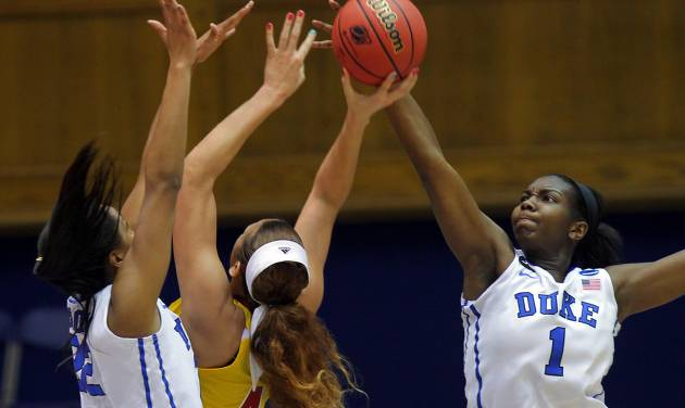 Duke's Elizabeth Williams blocks a shot by Winthrop's Schaquilla Nunn, also guarded by Duke's Oderah Chidom, during the first half of their first-round game in the NCAA basketball tournament in Durham, N.C., Saturday, March 22, 2014. (AP Photo/Ted Richardson)