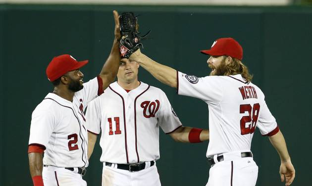Washington Nationals outfielders Denard Span, left, Ryan Zimmerman and Jayson Werth celebrate after an interleague baseball game against the Houston Astros at Nationals Park Wednesday, June 18, 2014, in Washington. The Nationals won 6-5. (AP Photo/Alex Brandon)