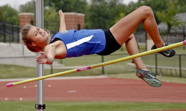 Deer Creek's Jessica Holley competes in the Class 5A girls high jump during the Class 6A and 5A state championship track meet at Yukon High School on Saturday, May 17, 2014 in Yukon, Okla.   Photo by Chris Landsberger, The Oklahoman